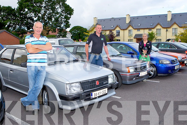 Three generations of Murphy's Dan left with his son Darren and grandson Aaron and Elaine O'Connor with their 1984 Astra, 1989 Vauxhell Nova GT and 2002 Coupe at Teds Opel-Vauxhall run 2013 which started at the Quality Hotel Killarney last Saturday morning