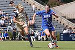 27 October 2013: Duke's Kelly Cobb (9) and Pittsburgh's Alyssa Meier (12). The Duke University Blue Devils hosted the Pittsburgh University Panthers at Koskinen Stadium in Durham, NC in a 2013 NCAA Division I Women's Soccer match. Duke won the game 6-3.
