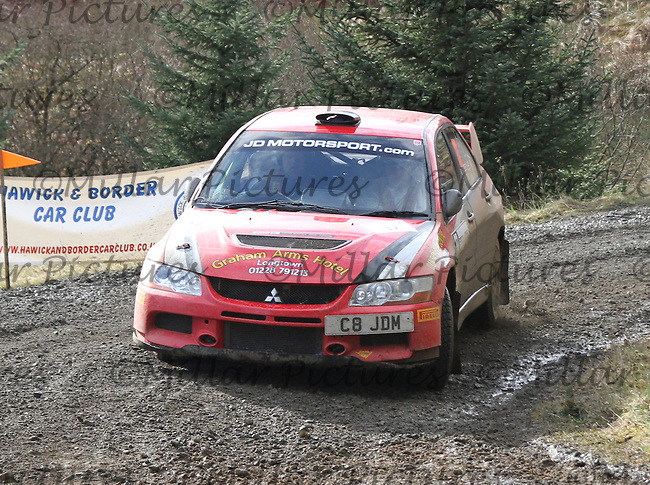 Darren Martin - Martin Steele in a Mitsubishi Lancer Evolution 9 at Junction 8 on Special Stage 5 Buck Fell on the Brick & Steel Border Counties Rally 2014, Round 2 of the RAC MSA Scottish Rally Championship sponsored by ARR Craib Transport Limited and other championships  and organised by Whickham & District and Hawick & Border Car Clubs and based in Jedburgh and held in Kielder Forest on 22.3.14.