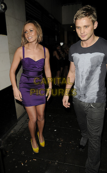 CHANELLE HAYES & JEFF BRAZIER.The Neon Management weekly club night launch party, Vendome bat & nightclub, Piccadilly, London, England..January 28th, 2009.full length big brother purple silk satin dress yellow shoes jeans denim black t-shirt print grey gray .CAP/CAN.©Can Nguyen/Capital Pictures.