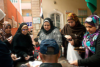 Egypt / Zagazig / 15.12.2012 / Egyptian women prepare to cast ballots during the country's constitutional referendum at a polling center in Zagazig. Tens of thousands of people descended on polling stations across Egypt to vote on the highly controversial draft constitution, which has been a source of intense political protest in recent weeks. © Giulia Marchi