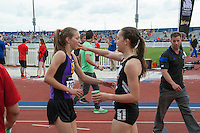 Stephanie Jenks (right) and Hannah Long reach out for a hug after their fast race in the 1600-meters at the 2015 Kansas Relays.