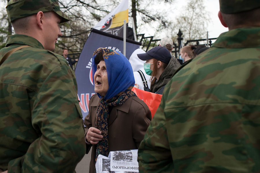 Moscow, Russia, 01/05/2010..A woman argues with conscript soldiers on duty at a demonstration of ultra nationalist and fascist groups in central Moscow. A variety of political groups took to the streets on the traditional Russian Mayday holiday.