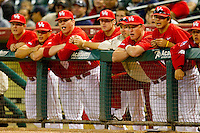 The Houston Cougars watch the action from the top step of the dugout during the game against the Texas A&M Aggies at Minute Maid Park on March 6, 2011 in Houston, Texas.  Photo by Brian Westerholt / Four Seam Images