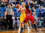 BROOKINGS, SD - NOVEMBER 12:  Madison Guebert #11 from South Dakota State University looks for a teammate around the defense of Nakiah Bell #2 from Southern Illinois Edwardsville at Frost Arena November 13, 2016 in Brookings, South Dakota. (Photo by Dave Eggen/Inertia)
