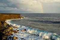 rainbow and a crumbling coastline, Kalapana, Hawaii, Big Island of Hawaii