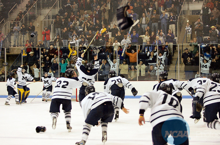 19 MAR 2005:  Middlebury College races onto the ice in celebration after defeating the University of St. Thomas during the Division III Men's Ice Hockey Championship held at Kenyon Arena on the Middlebury College campus in Middlebury, VT.  Middlebury defeated St. Thomas 5-0 for the national title.  Alden Pellett/NCAA Photos