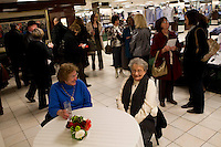 Shoppers attend the Romare Bearden Foundation event that included a performance by Sean Jones and members of the Pittsburgh Symphony Orchestra at the Macy's store in downtown Pittsburgh, Pennsylvania on February 9, 2012.