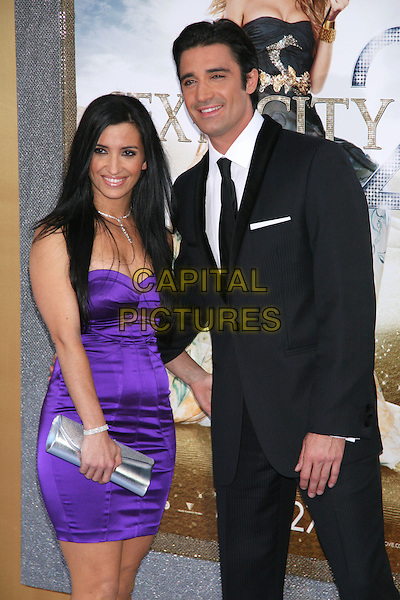 CAROLE MARINI & GILLES MARINI.Attending the World Film Premiere of 'Sex and the City 2' at Radio City Music Hall in New York City, New York, NY, USA. .May 24th, 2010.SATC half length 3/4 purple dress black suit married husband wife silver clutch bag .CAP/LNC/TOM.©TOM/LNC/Capital Pictures.