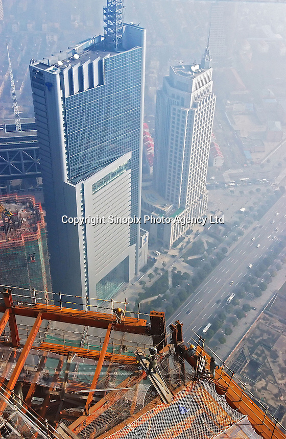 Workers assemble iron girders on the 66th and 67th floors of the Mori Tower, or the Shanghai World Financial Centre, currently under construction in Shanghai. The 101-storey building, due to be completed in 2008, will be the world's tallest.