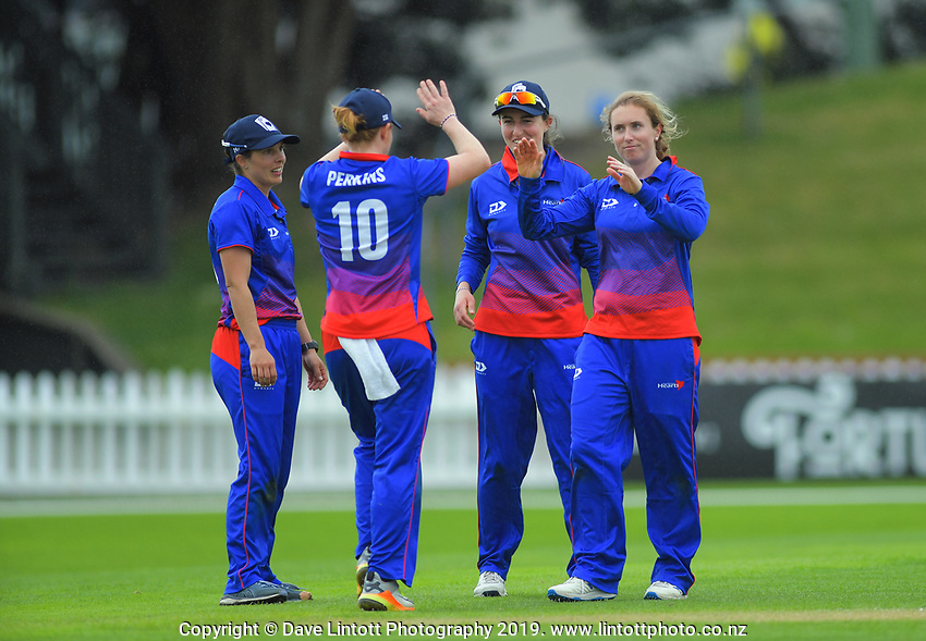 Auckland's Katie Perkins (10) congratulates bowler Anna Johnson on catching Wellington's Caitlin King during the women's Hallyburton Johnstone Shield cricket match between the Wellington Blaze and Auckland Hearts at Basin Reserve in Wellington, New Zealand on Sunday, 17 November 2019. Photo: Dave Lintott / lintottphoto.co.nz