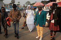 "KINSHASA, DEMOCRATIC REPUBLIC OF CONGO - July 16: Sapeurs from the group Leopard de la Sape walk the streets on July 16, 2014, in Kinshasa, DRC. The word Sapeur comes from SAPE, a French acronym for Société des Ambianceurs et Persons Élégants or Society of Revellers and Elegant People and it also means, to dress with elegance and style"". Most of the young Sapeurs are unemployed, poor and live in harsh conditions in Kinshasa, a city of about 10 million people. For many of them being a Sapeur means they can escape their daily struggles and dress like fashionable Europeans. Many hustle to build up their expensive collections. Most Sapeurs could never afford to visit Paris, and usually relatives send or bring clothes back to Kinshasa. (Photo by Per-Anders Pettersson)"