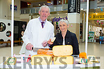 Jim O'Brien from O'Brien's Cheese with Margaret Shanahan from Farranfore at the Taste of Tralee Food Fair Manor West Retail Park on Saturday