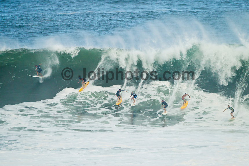 "Waimea Bay, Haleiwa, Oahu, Hawaii (Thursday January 20, 2011) .George Downing (HAW) , Contest Director of The Quiksilver In Memory of Eddie Aikau,has called a ""NO GO"" for competition at Waimea Bay today, based upon the inconsistency of the swell. While there were definitely 20- to 25-foot waves sporadically throughout the morning, the consistency of those large waves was deemed to be insufficient to run the two rounds of competition. The event still has until February 28 to run...""What we see in conditions like this is just one or two true 'Eddie' size waves in the period of a heat,"" said Downing. ""With seven surfers in the water per heat, that is not the kind of playing field we need for quality, fair competition...""It's very easy to get caught up in the excitement when those huge waves come through, and after all of the efforts of the crew and the spectators to get ready for this day. But what keeps this event the greatest big wave event in the world is never relaxing those standards. Eddie never did...""We will continue to wait. The holding period runs through February 28 and we know that there is definite potential in the coming weeks for more extra large surf to arise. If that day comes, we will be ready to go again...The 15,000-strong crowd that had gathered under moonlight since the very early hours of the morning understood the call and settled in for the day, regardless. With the world's best big wave riders making the most of the opportunity to put some time in at Waimea, they will be treated to spectacular rides throughout the day, without question...2002 Eddie winner and 10X world champion Kelly Slater was in firm agreement with the decision: ""It's a good call."" said Slater. ""There are big waves out there, but there's not that many of them. It's not what we need..Photo: joliphotos.com"