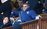 Dean Shiels on his crutches in the directors box