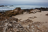 Rocks, sand, ocean and sky - Pescadero State Beach, California.
