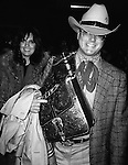 Larry Hagman and Linda Gray  ( DALLAS ).Arriving at Kennedy Airport,.New York City.February 1982.
