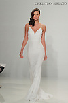 Model walks runway in a slip dress, from the Christian Siriano for Kleinfeld bridal collection, at Kleinfeld on April 18, 2016 during New York Bridal Fashion Week Spring Summer 2017.