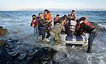 When he landed on the Greek island of Lesbos on October 30, 2015, Nabil Minas, a refugee from Syria, carried his children through the water--including the daughter he carries second from the left--and deposited them on the shore, then fell on his face and kissed the ground. A Christian, he crossed himself and covered his face with his hands, weeping with joy. Minas and his family came in the boat from Turkey, paying an exorbitant amount to traffickers who provided the transport.