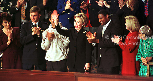 First lady Hillary Rodham Clinton acknowledges applause during the State of the Union Address in the Capitol in Washington, D.C. on 19 January, 1999.  .Credit: Ron Sachs / CNP