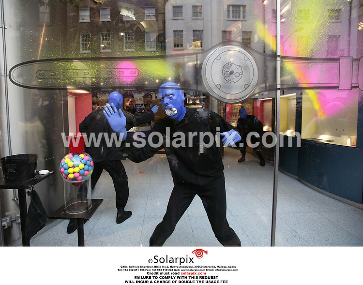 ALL ROUND PICTURES FROM SOLARPIX.COM.*MUST CREDIT SOLARPIX.COM OR DOUBLE FEE WILL BE CHARGED*.**NO PUBLICATION IN FRANCE, SCANDANAVIA, AUSTRALIA AND GERMANY FOR PUBLICATION IN THE UK MAGAZINES**.The Blue Man Group were in London's Covent Garden today to launch a specially created 'Blue Man Group watch' as part of Swatch's new Jelly In Jelly range,The watches go on sale this year..DATE:02.06.06-JOB REF:2448-SFE