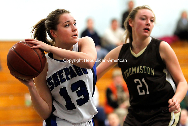 Washington, CT-05 December 2012-120512CM06- Shepaug's Brooke Parker looks for an open teammate as Thomaston's Bryttnie Thomas (21) defends Wednesday night in Washington.  Thomaston won big, 67-16.   Christopher Massa Republican-American