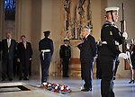 Chilean President Sebastian Pinera pauses for a minutes silence after laying a wreath at the Tomb of the Unknown Soldier during a tour of the Australian War Memorial Canberra, Tuesday September 11th 2012. AFP PHOTO / Mark GRAHAM
