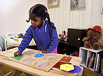 Berkeley, Girl, three-years-old experimenting with shapes puzzle at home  MR