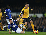 Leighton Baines of Everton makes a last ditch tackle on Mesut Ozil of Arsenal during the English Premier League match at Goodison Park Stadium, Liverpool. Picture date: December 13th, 2016. Pic Simon Bellis/Sportimage