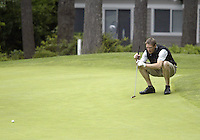 25 June, 2007: Detlef Schrempf takes a look at his shot before putting during the 14th annual Detlef Schrempf Celebrity Golf Classic at McCormick Woods golf course in Port Orchard, Washington.