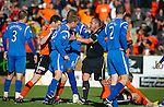 Dundee Utd v St Johnstone...25.09.10  .Ref Brian Winter separates Steven Anderson and Jon Daly after Anderson fouled David Goodwillie and was booked.Picture by Graeme Hart..Copyright Perthshire Picture Agency.Tel: 01738 623350  Mobile: 07990 594431