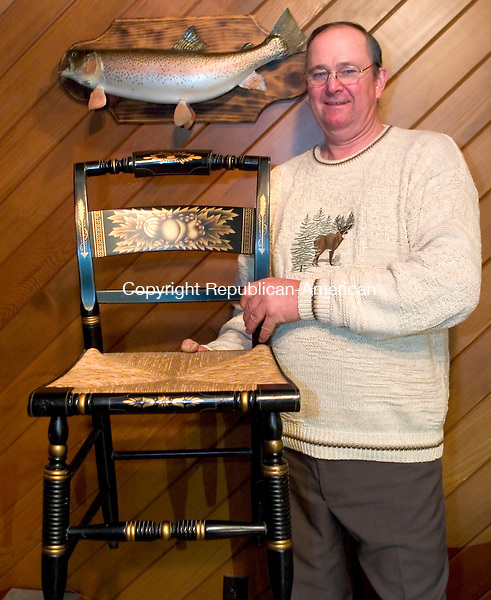 BRISTOL, CT - 12 APRIL 2006 -041206JT06--<br /> Richard Leide won a Hitchcock chair in 1983 for catching the trout hanging on the wall behind him at the annual fishing derby in Riverton. <br /> Josalee Thrift Republican-American