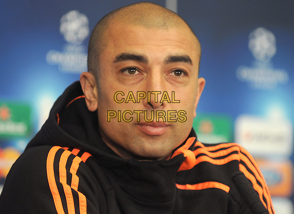 Chelsea Manager Roberto Di Matteo .At Champions League Press Conference - Chelsea v Benfica at Stamford Bridge, London, England..April 3rd 2012.headshot portrait black orange  .CAP/PP/BK.©Bob Kent/PP/Capital Pictures.
