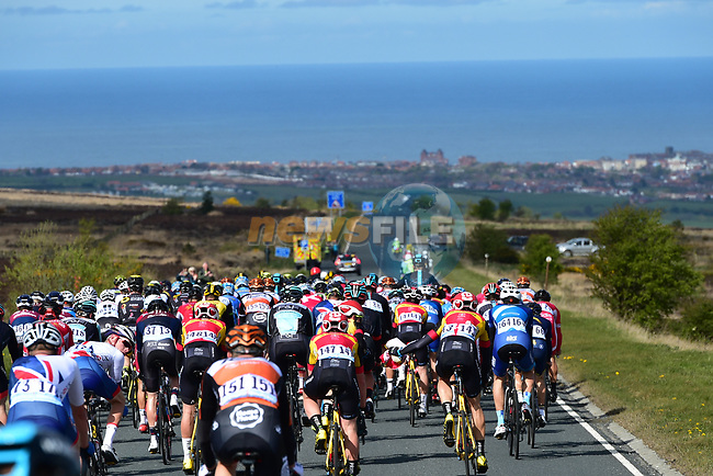 The peloton approach Whitby during Stage 1 of the Tour de Yorkshire 2017 running 174km from Bridlington to Scarborough, England. 28th April 2017. <br /> Picture: ASO/P.Ballet | Cyclefile<br /> <br /> <br /> All photos usage must carry mandatory copyright credit (&copy; Cyclefile | ASO/P.Ballet)
