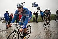 Jempy Drucker (LUX) with Tom Boonen (BEL) in tow over the cobbles of the Holleweg<br /> <br /> Omloop Het Nieuwsblad 2014