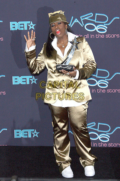 MISSY ELLIOTT.winner, Best Female Hip Hop award.  .2006 BET Awards - Press Room held at the Shrine Auditorium, Los Angeles, California, USA. .June 27th, 2006.Photo: Zach Lipp/AdMedia/Capital Pictures.Ref: ZL/ADM.full length award trophy gold metallic jacket hat baseball cap hand palm funny.www.capitalpictures.com.sales@capitalpictures.com.© Capital Pictures.