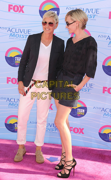 Ellen DeGeneres, Portia de Rossi.FOX's 2012 Teen Choice Awards held at The Gibson Ampitheatre in Universal City, California, USA..July 22nd, 2012.full length blue shorts hands in pockets black top strappy sandals sunglasses shades blazer white cream top belt profile couple married wife life partners .CAP/ROT/TM.©Tony Michaels/Roth Stock/Capital Pictures