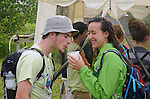 Two Volunteers sharing a drink, before going on duty at the Falcon Ridge Folk Festival, held on Dodd's Farm in Hillsdale, NY on Saturday, August 1, 2015. Photo by Jim Peppler. Copyright Jim Peppler 2015.