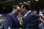07 February 2015: Duke head coach Mike Krzyzewski (left) and Notre Dame head coach Mike Brey (right) shake hands before the game. The Duke University Blue Devils hosted the University of Notre Dame Fighting Irish at Cameron Indoor Stadium in Durham, North Carolina in a 2014-16 NCAA Men's Basketball Division I game. Duke won the game 90-60.