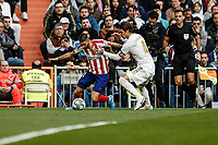 1st February 2020; Estadio Santiago Bernabeu, Madrid, Spain; La Liga Football, Real Madrid versus Atletico de Madrid; Sergio Ramos (Real Madrid) challenges Yannick Carrasco (Atletico de Madrid)
