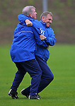 John Greig tackles Bert Van Lingen on the training ground
