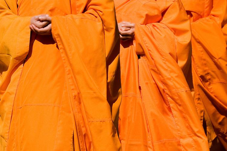 Orange robed Buddhist monks.