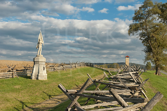 Antietam National Military Park, Sunken Road and Bloody Lane fence line and memorial statue, Observation Tower in distance, Sharpsburg, MD, USA.
