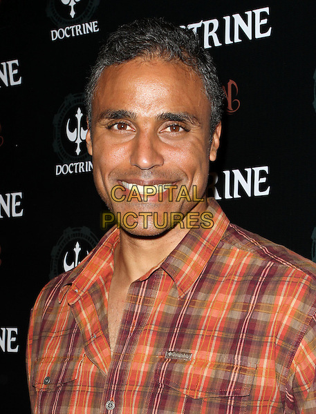 RICK FOX .Doctrine Clothing and Devotion Vodka Launch held at Sky Bar at Boudoir, West Hollywood, CA, USA, .12th October 2010..portrait headshot smiling  red orange plaid shirt .CAP/ADM/KB.©Kevan Brooks/AdMedia/Capital Pictures.