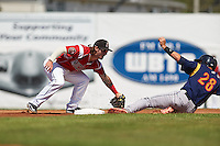 Batavia Muckdogs second baseman Taylor Munden (21) tags Jhohan Acevedo (28) sliding in during a game against the State College Spikes August 23, 2015 at Dwyer Stadium in Batavia, New York.  State College defeated Batavia 8-2.  (Mike Janes/Four Seam Images)