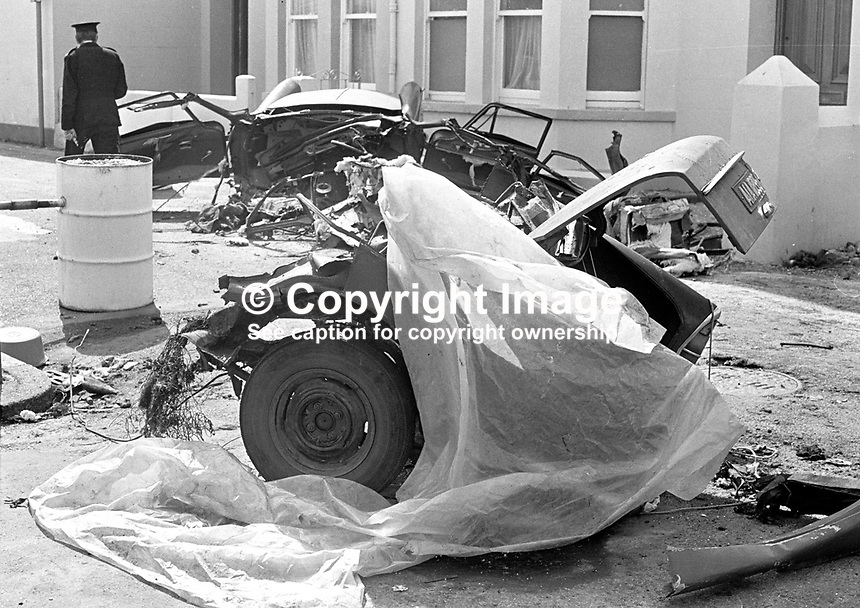 The scene of devastation in Causeway Road, Newcastle, Co Down, N Ireland, UK, after a Provisional IRA bomb exploded en route to a target. The bombers, an engaged couple, died instantaneously in the blast as their car was ripped apart. The incident happened just before midnight on 21st July 1973 in a quiet suburb of one of N Ireland's most popular seaside resorts. The couple, both 21 years, who died were Alphonsus Cunningham, from nearby Annalong, and Pauline Kane, from Castlewellan. 197307210513b<br />