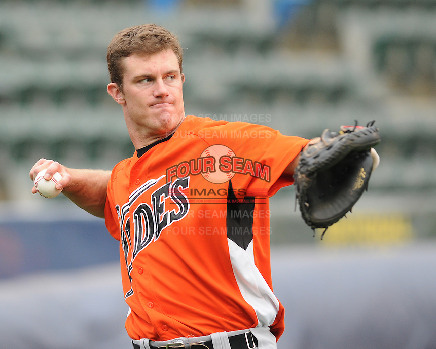 Catcher John Hester (19) of the Norfolk Tides, International League affiliate of the Baltimore Orioles, prior to a game against the Scranton/Wilkes-Barre Yankees on June 20, 2011, at PNC Park in Moosic, Pennsylvania. (Tom Priddy/Four Seam Images)