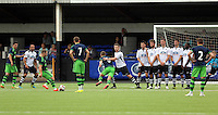 Pictured: Kyle Copp of Swansea (L) takes a free kick Saturday 11 July 2015<br />