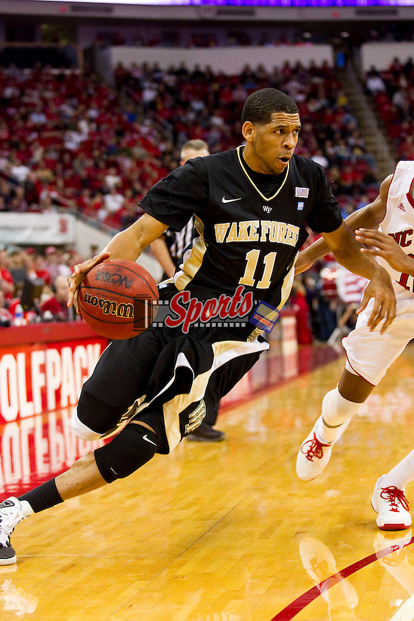 C.J. Harris #11 of the Wake Forest Demon Deacons drives the baseline during first half action against the North Carolina State Wolfpack at the RBC Center on January 8, 2011 in Raleigh, North Carolina.  The Wolfpack defeated the Demon Deacons 90-69.  Photo by Brian Westerholt / Sports On Film