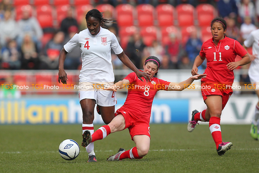 Anita Asante of England evades the challenge of Diana Matheson of Canada - England Women vs Canada Women - International Football Friendly Match at the New York Stadium, Rotherham United FC - 07/04/13 - MANDATORY CREDIT: Gavin Ellis/TGSPHOTO - Self billing applies where appropriate - 0845 094 6026 - contact@tgsphoto.co.uk - NO UNPAID USE.